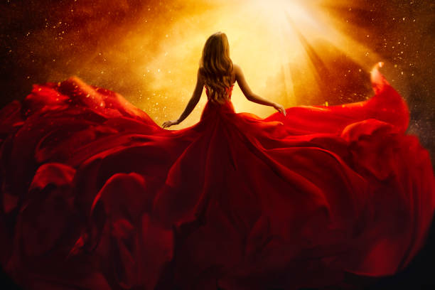 Fashion Model Back Side in Red Flying Dress, Woman Rear View, Gown Fabric Fly on Wind, Beautiful Girl Looking to Light Fashion Model Back Side in Red Flying Dress, Woman Rear View, Gown Fabric Fly on Wind, Beautiful Girl Looking to Light sun shining through dresses stock pictures, royalty-free photos & images