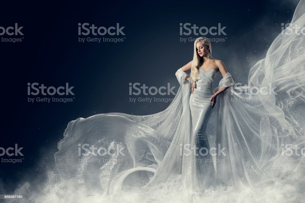 Fashion Model Beauty Dress, Waving Silver Cloth Gown, Woman in White Fluttering Clothes Fabric stock photo