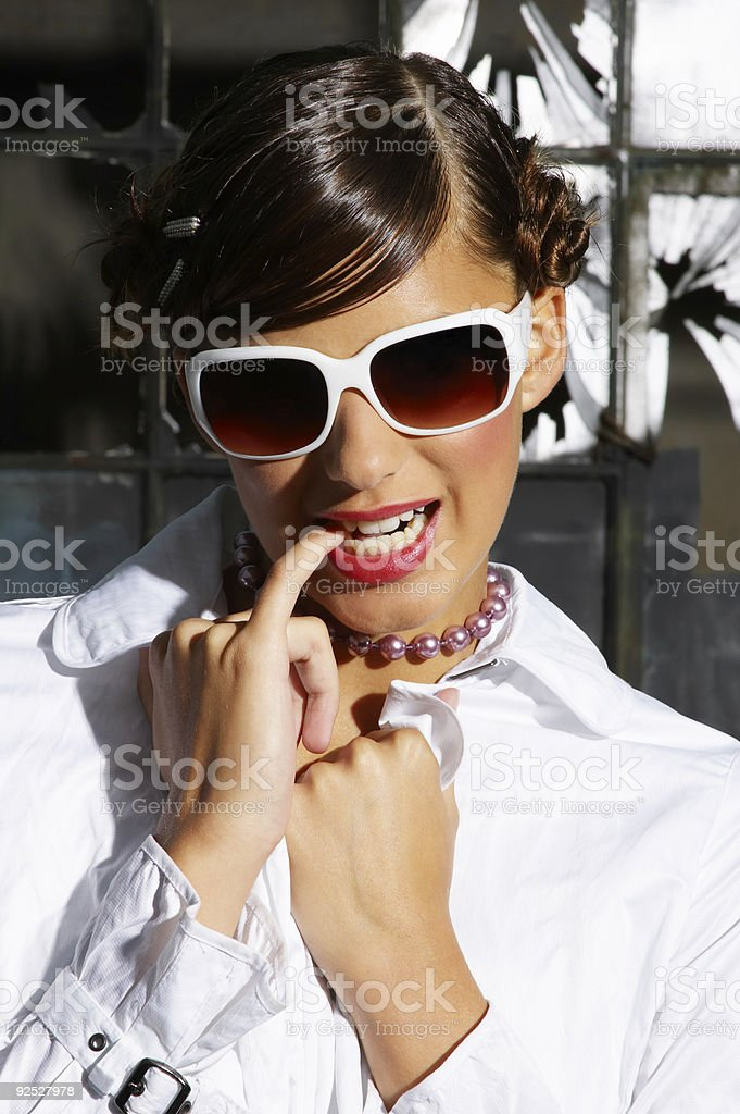Fashion model biting her little finger (closeup) royalty-free stock photo