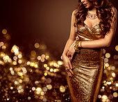 ファッション モデル本体ドレスはゴールド、女性のエレガントな黄金セクシーなドレス