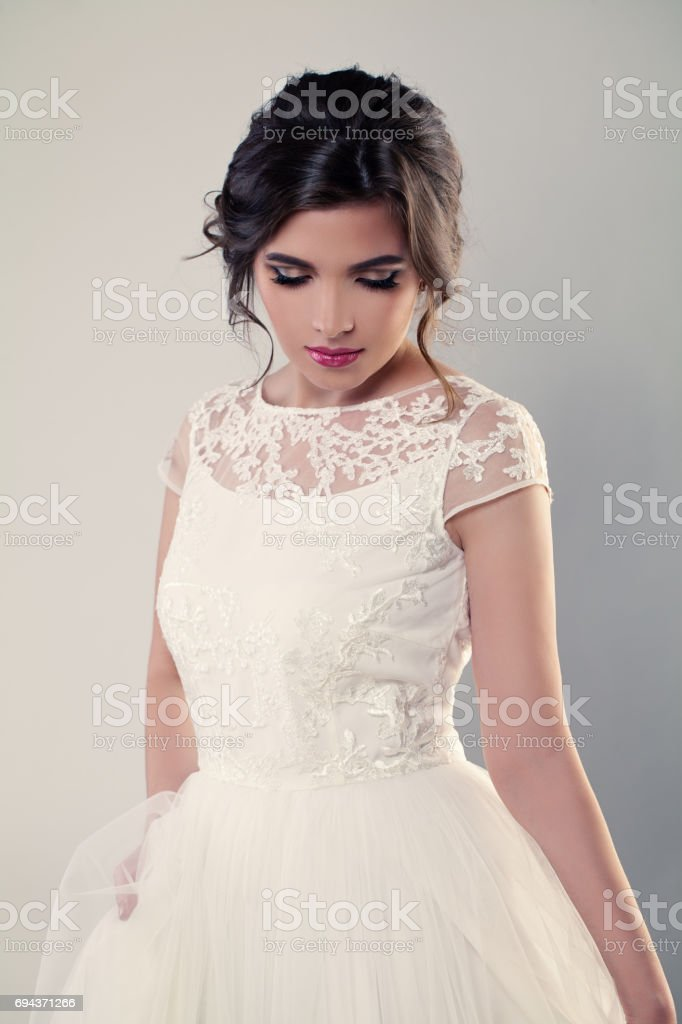 Fashion Model Bride In White Dress Wedding Makeup And Hairstyle