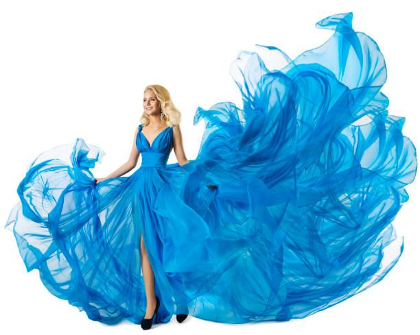 fashion model dancing blue dress flying fabric, woman waving gown - abendkleid lang blau stock-fotos und bilder