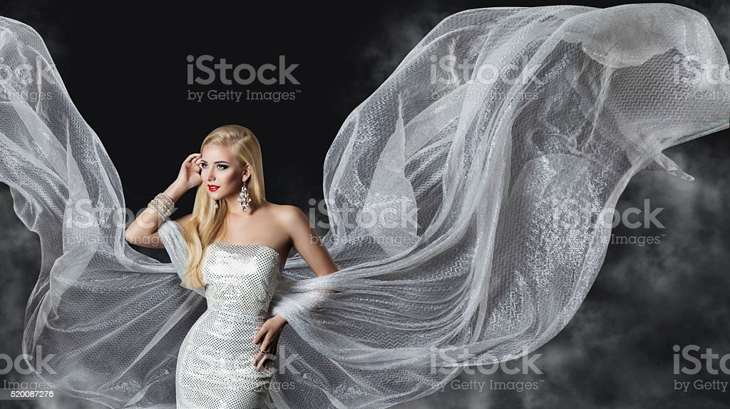 Fashion Model Dress, Woman Flowing Cloth Wings, Girl Silver Fabric stock photo