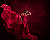 Fashion Model Dress, Woman in Flying Gown, Silk Fabric Waving on Wind, Satin Cloth Flowing Waves