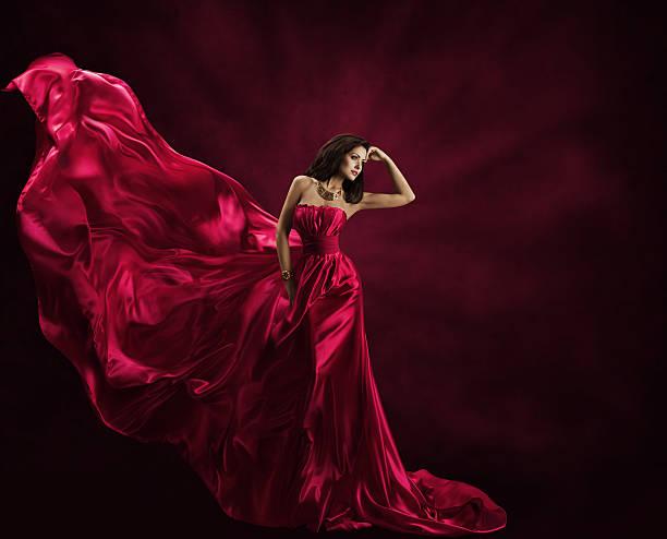 fashion model dress, woman in flying gown, waving silk fabric - lange abendkleider stock-fotos und bilder