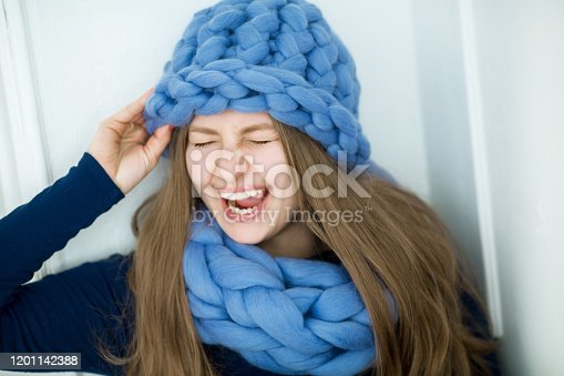 884727654 istock photo Fashion model dressed in natural knitted dense viscous things made of natural wool 1201142388