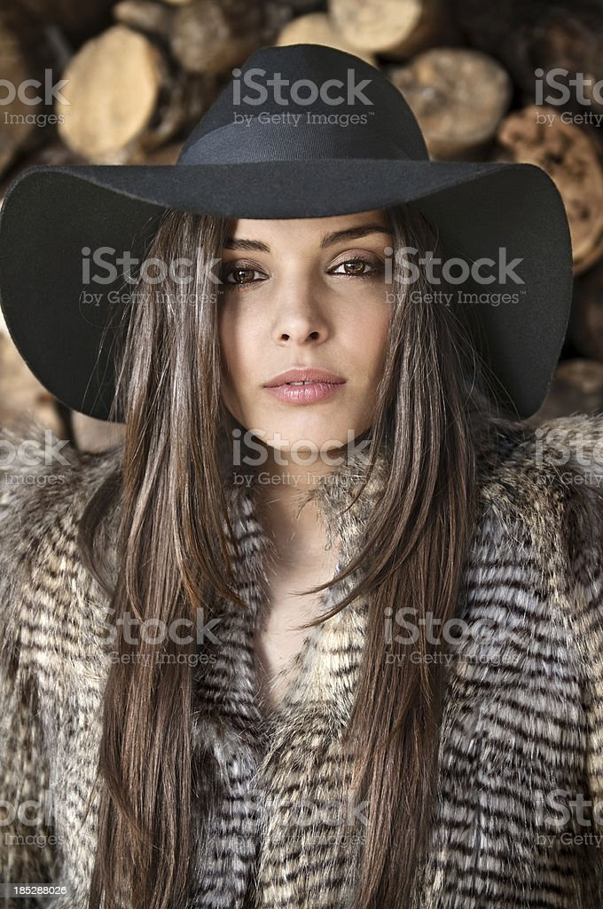 Fashion model dressed with coat and hat royalty-free stock photo