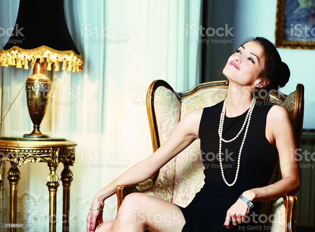 Fashion model enjoys the riches stock photo