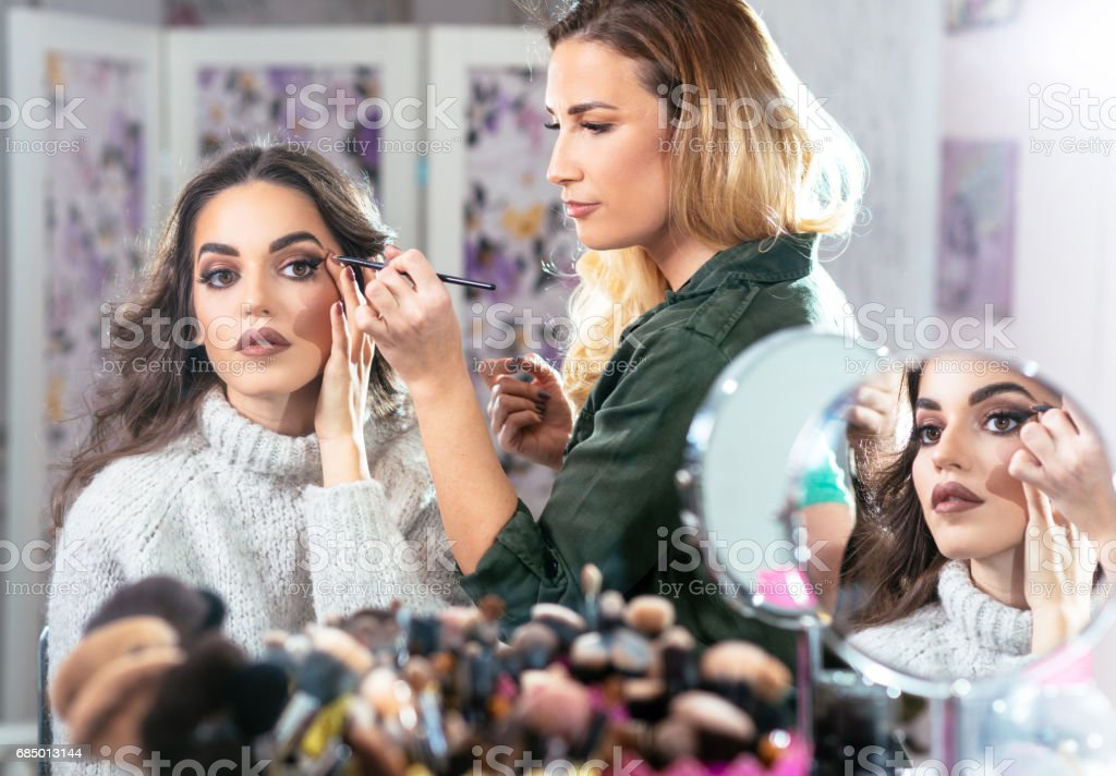 Fashion model getting ready for catwalk stock photo