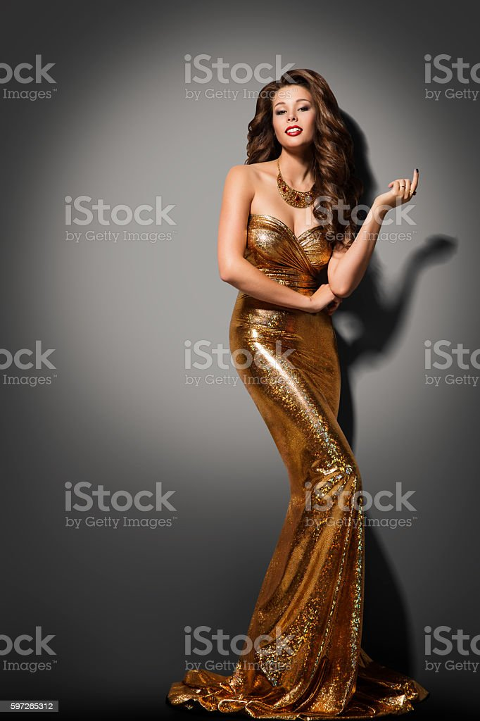 Fashion Model Girl Posing Glamour Gold Dress, Elegant Woman Gown stock photo