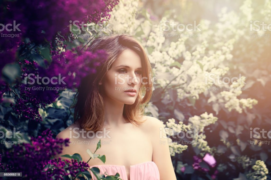 Fashion Model Girl with Long Bob Hair. Young Beautiful Woman on Flowers Background stock photo