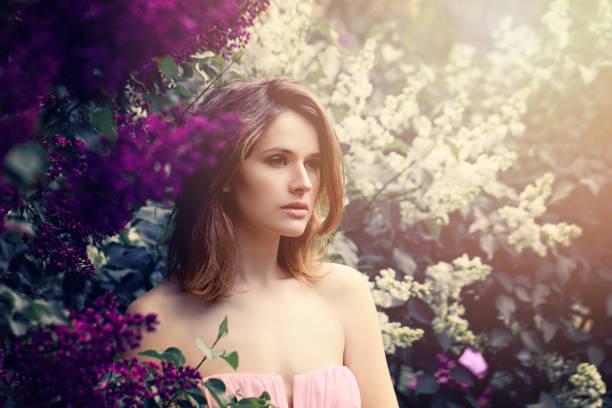 fashion model girl with long bob hair. young beautiful woman on flowers background - prom fashion stock photos and pictures