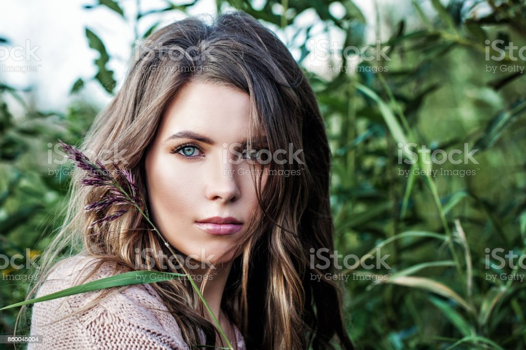 Fashion Model Girl with Long Healthy Hair. Beautiful Woman with Healthy and Beauty Brown Hair stock photo