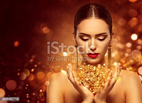istock Fashion Model Gold Jewelry in Hands, Golden Woman Beauty 658462716