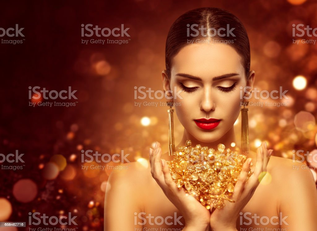 Fashion Model Gold Jewelry in Hands, Golden Woman Beauty stock photo