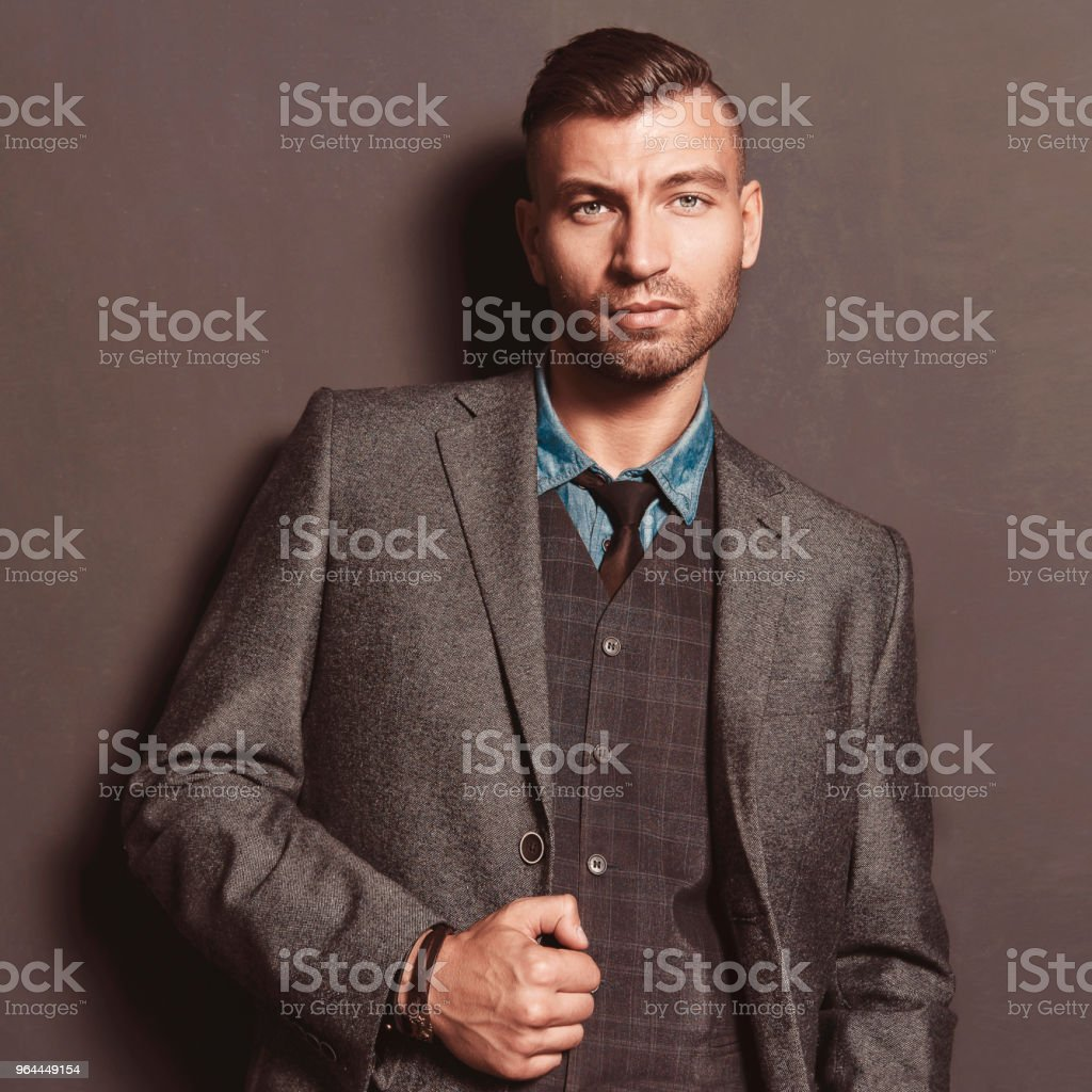 b8168104f5 Elegant fashionable beautiful brutal man with hairdro. Portrait of sexy  attractive rich man. - Stock image .