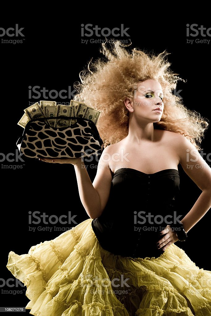 Fashion Model Holding Purse Full of Money royalty-free stock photo
