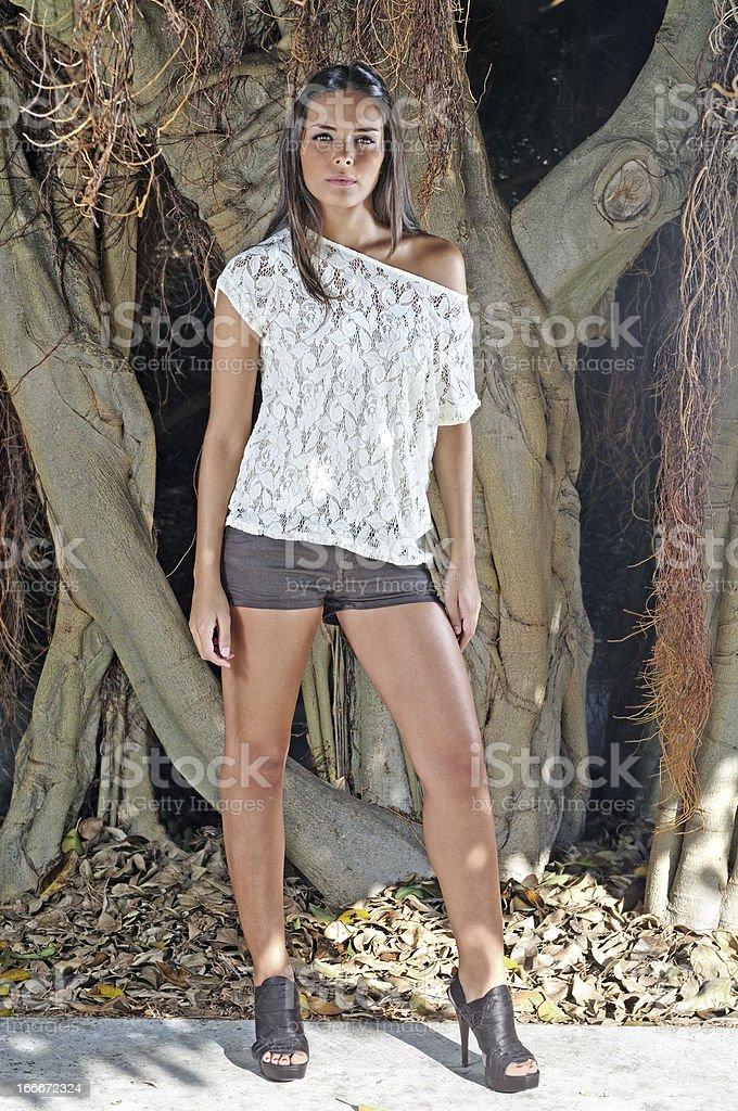 Fashion model in a botanic garden royalty-free stock photo