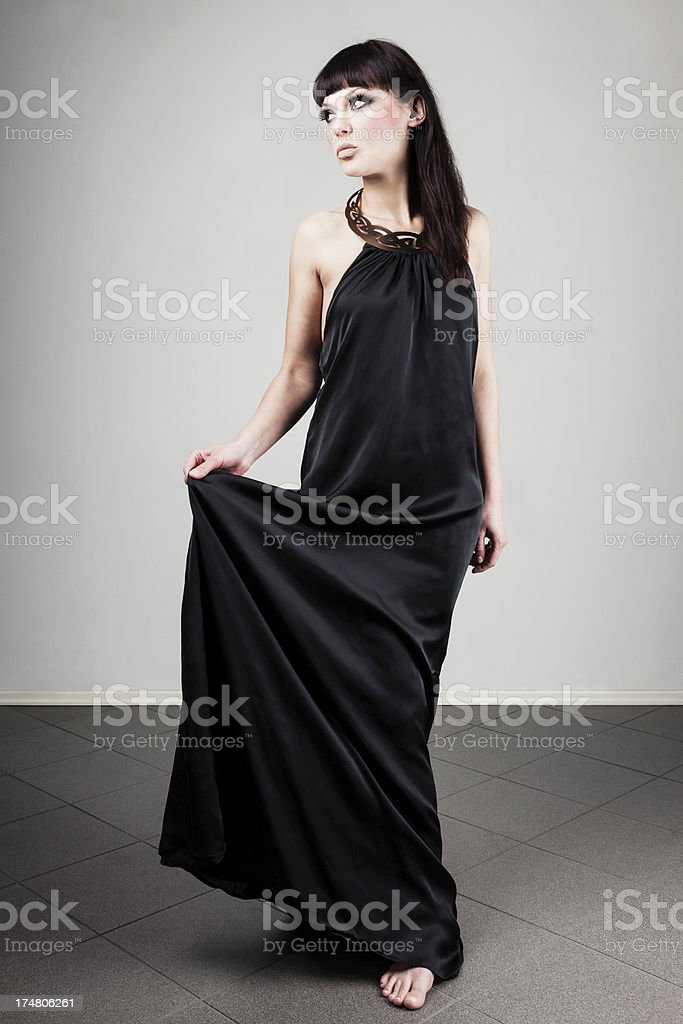 Fashion model in black dress royalty-free stock photo