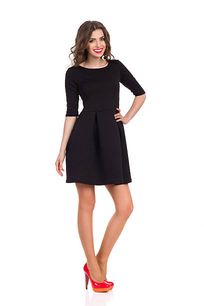 fashion model in black mini dress - mini dress stock photos and pictures