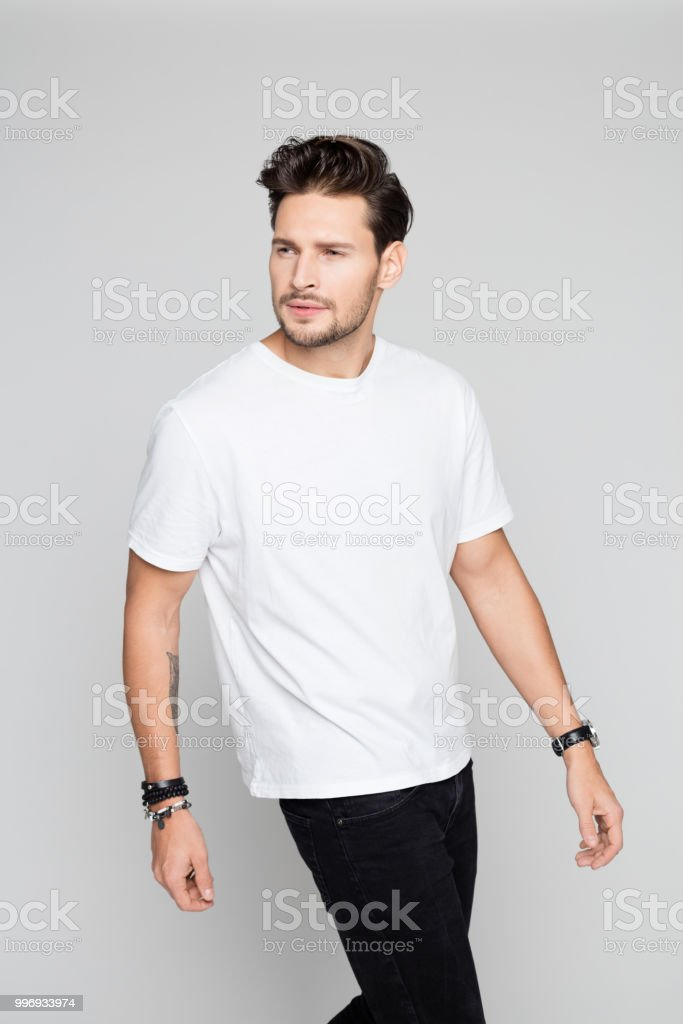 Fashion model in casuals Portrait of fashion model in casuals on grey background 25-29 Years Stock Photo
