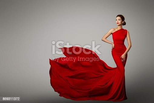 istock Fashion Model in Red Beauty Dress, Sexy Woman posing evening Gown, Flying Silk Tail 859311372