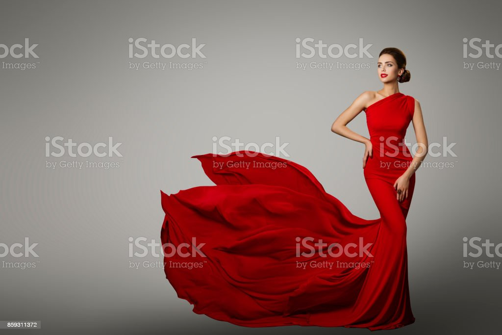 Fashion Model in Red Beauty Dress, Sexy Woman posing evening Gown, Flying Silk Tail stock photo