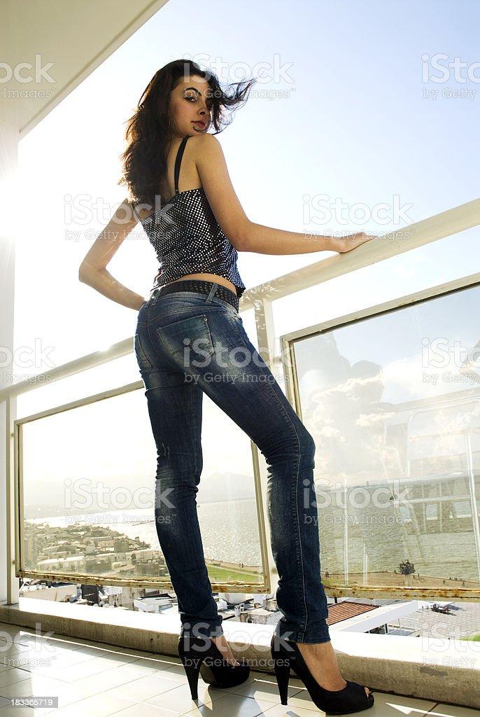 Fashion model in the balcony royalty-free stock photo