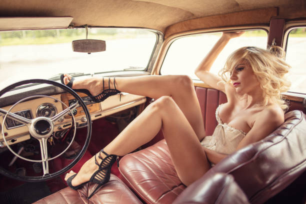 Fashion model in vintage car stock photo