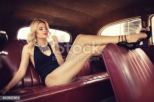 istock Fashion model in vintage car. Retro style 542932924