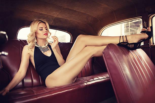 Fashion model in vintage car. Retro style stock photo