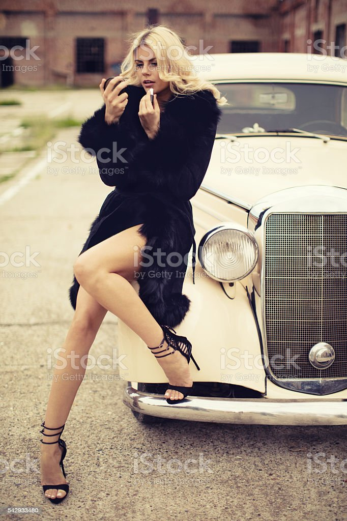 Fashion model in vintage car. Retro style - foto de acervo