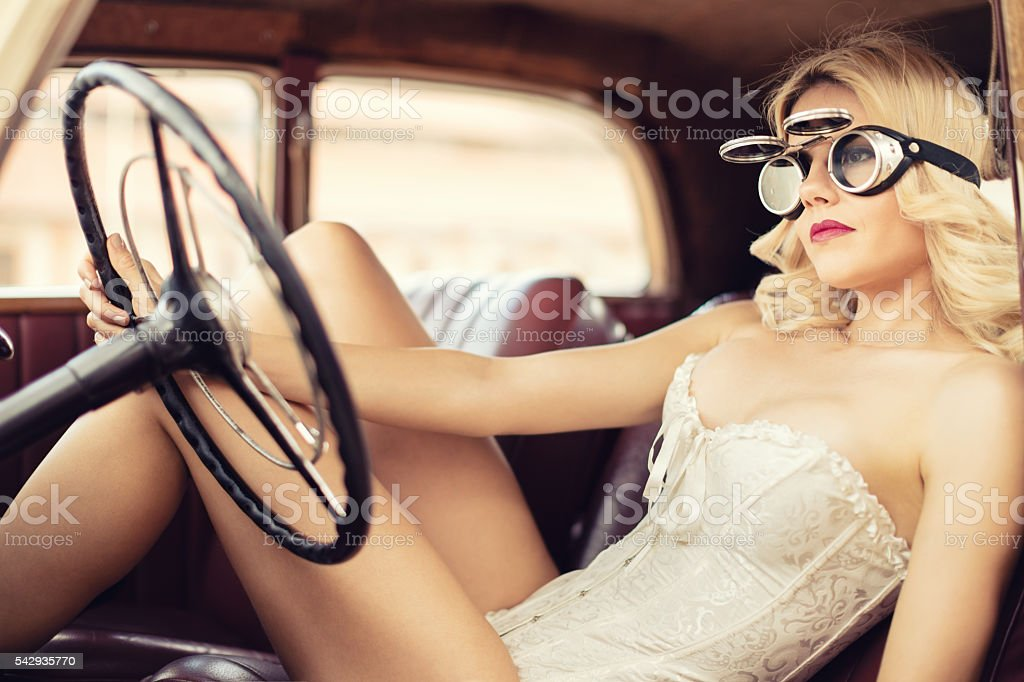 Fashion model in vintage car. Retro style stock photo