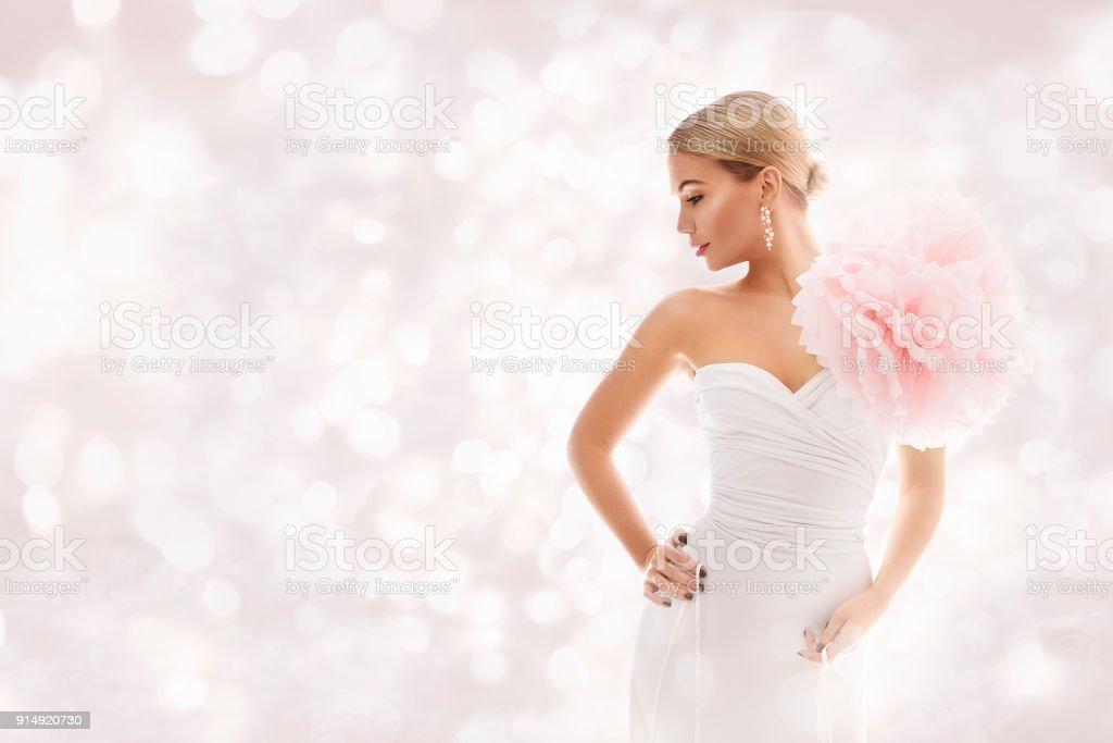 Fashion Model in White Dress, Elegant Woman Beauty Gown Artistic Flower, Beautiful Lady Portrait stock photo