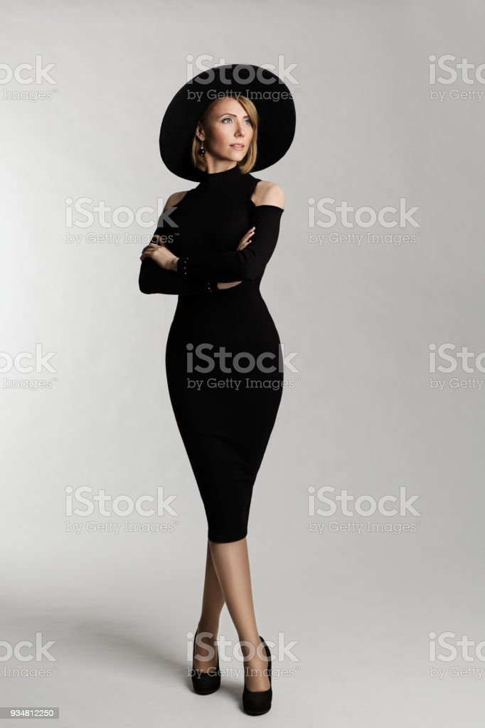 Fashion Model Long Dress, Hat Wide Brimmed, Elegant Woman Beauty Portrait, Lady on White background stock photo