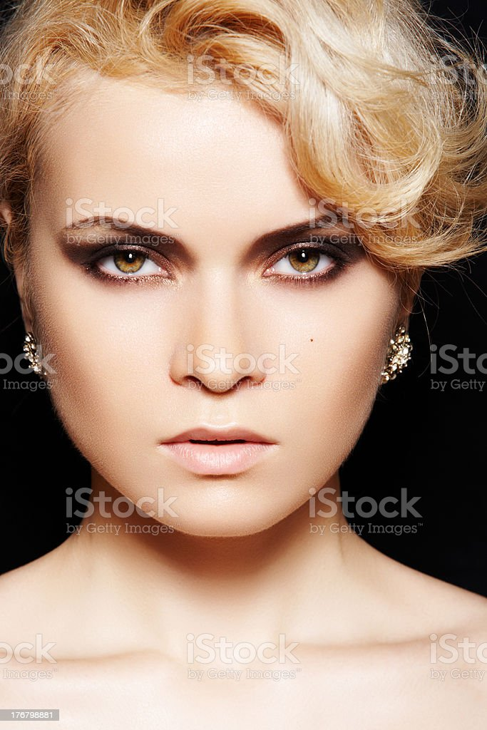 Fashion model. Make-up, blond hair, shiny jewelry stock photo