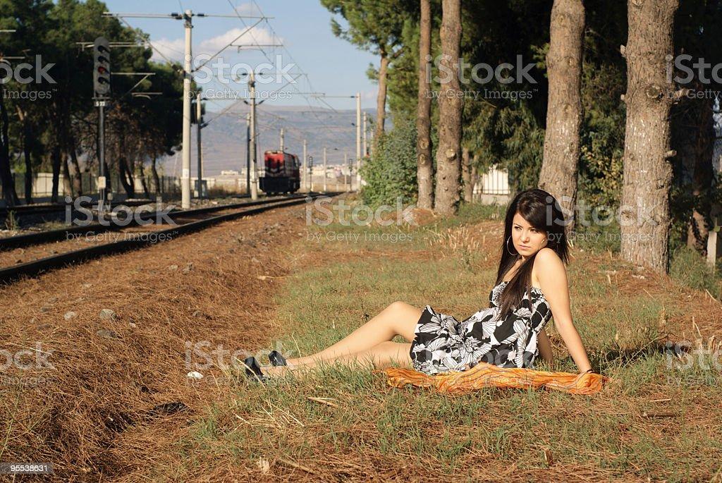 fashion model next to the railroad royalty-free stock photo