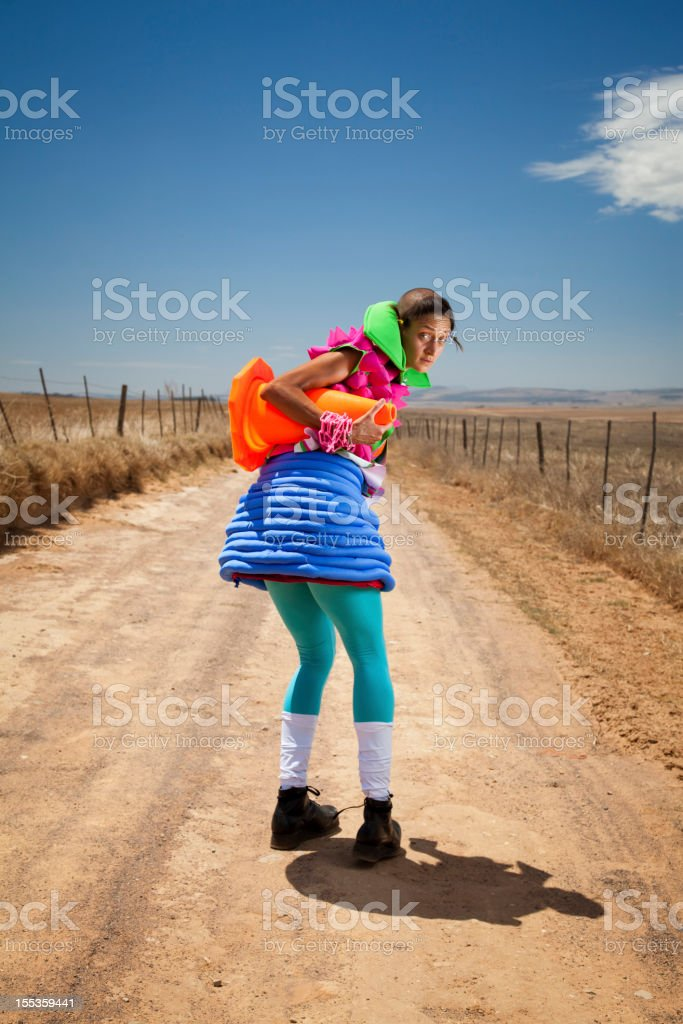 Fashion  Model  On Dirt Road With Traffic Cone Under Arm royalty-free stock photo