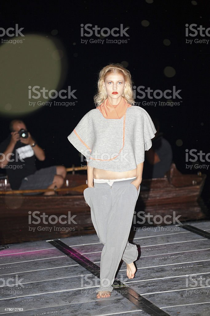 fashion model on floating catwalk with paparazzi at night royalty-free stock photo