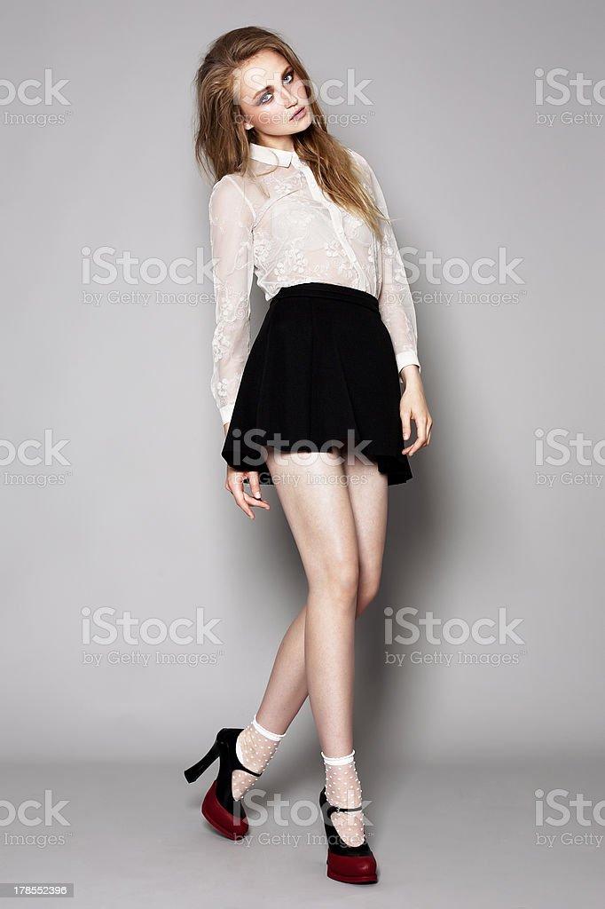 Fashion model on grey background stock photo