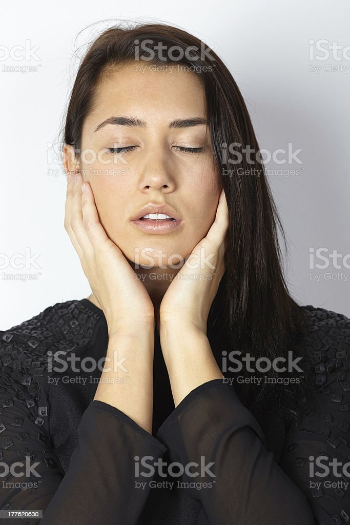 Fashion model portrait eyes closed hands on chin royalty-free stock photo