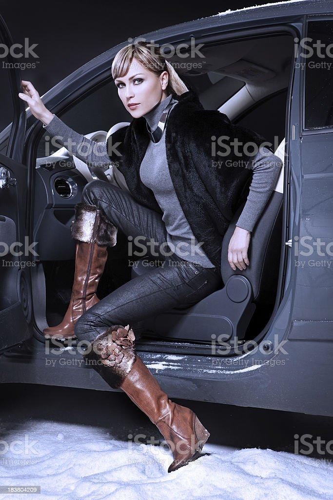 fashion model posing in car royalty-free stock photo