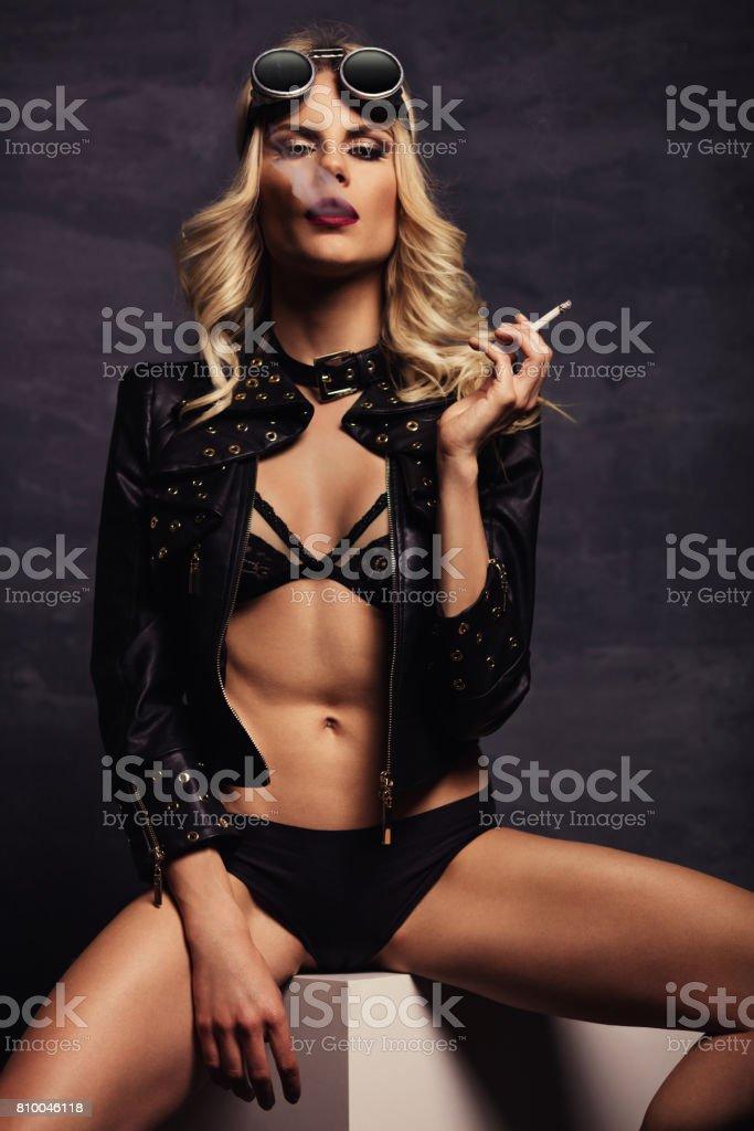 Fashion model posing in studio stock photo