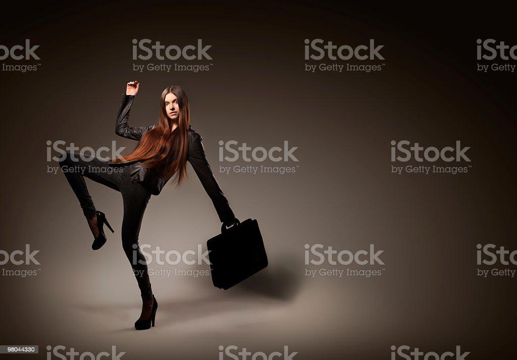 Fashion model posing on dark background royalty-free stock photo