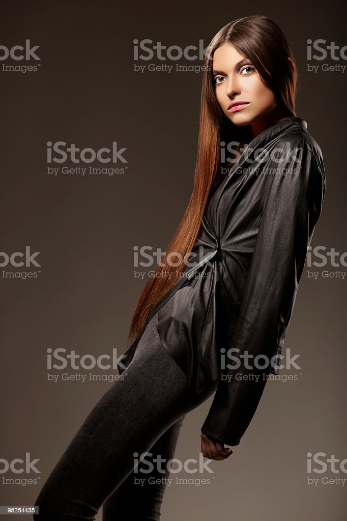 Fashion model posing on dark background royalty-free stock photo