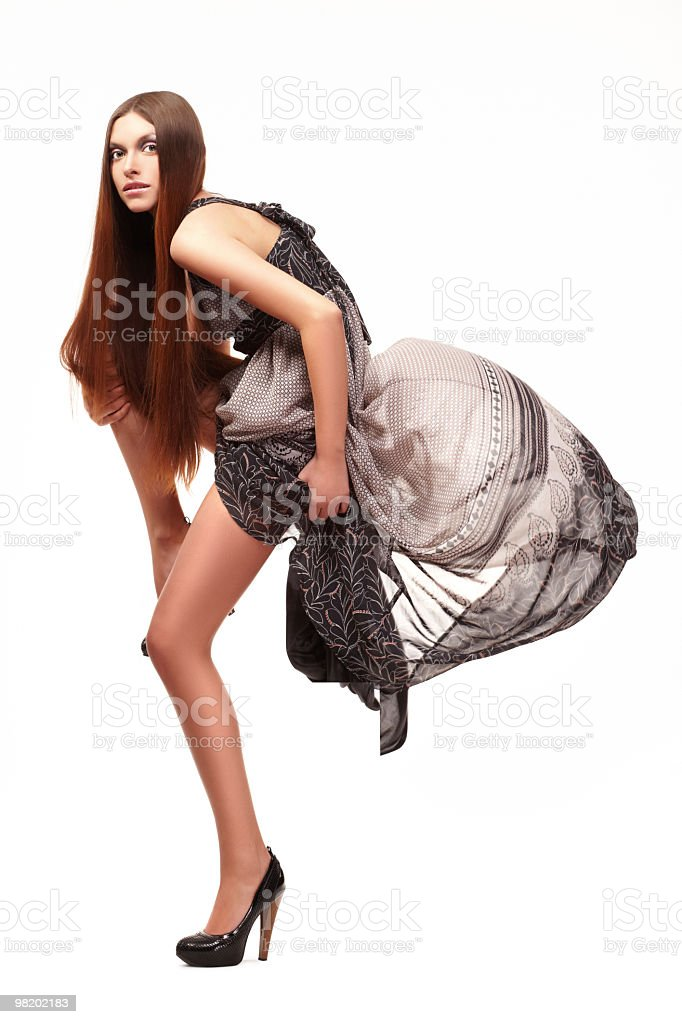 Fashion model posing on white background royalty-free stock photo