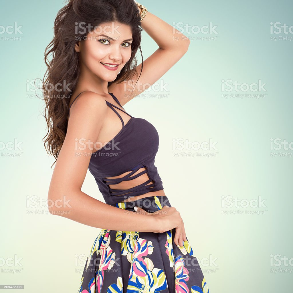 Fashion model posing over colored backround stock photo