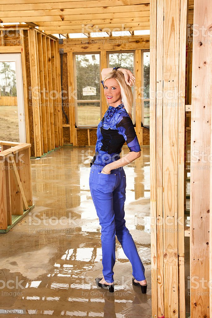 Fashion model posing with smile in home under construction royalty-free stock photo