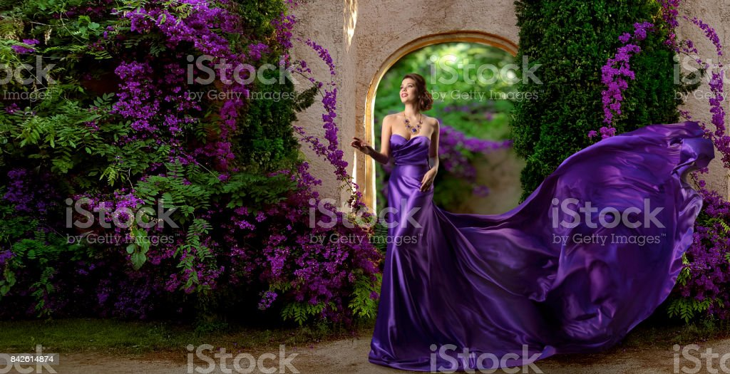 Fashion Model Purple Dress, Woman Long Silk Gown, Violet Garden Flowers, Flying Fabric stock photo