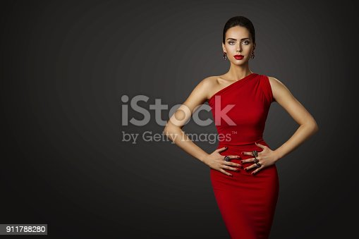 Fashion Model Red Dress, Elegant Woman in Sexy Evening Gown, Beautiful Girl Studio Shot over Black Background